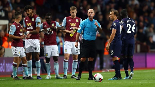 Mike Dean sends off West Ham's Arthur Masuaku at Villa Park. Photograph: Michael Steele/Getty