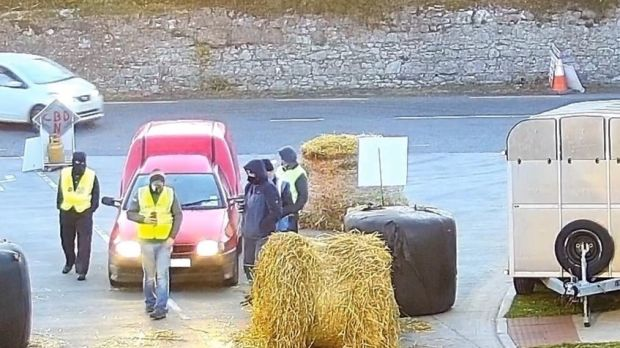 A photograph supplied by ABP, showing what the company said were protesters wearing balaclavas allegedly outside its Cahir facility. Photograph: ABP