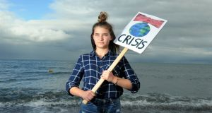 "Climate activist Lucy Sky Dunne (14): ""Everyone needs to know about this – it's not something that can be learned by some, but not others. It's something that's going to affect literally everyone."" Photograph: Aidan Crawley for The Irish Times"