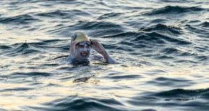 Sarah Thomas, 37, who has become the first person to swim across the English Channel four times in a row, completing the feat of endurance at about 6.30am after more than 54 hours of swimming. Photograph: Jon Washer/PA