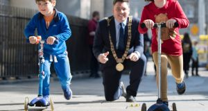 Lord Mayor Paul McAuliffe with Samuel, Rathfarnham and Saoirse from Marino launching details of Car Free Day 2019. Photograph: Arthur Carron