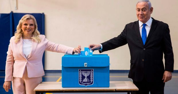 Israeli prime minister Binyamin Netanyahu and his wife Sara casts their votes at a voting station in Jerusalem. Photograph: Heidi Levine/ AFP/Getty Images
