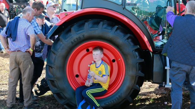Luke Whyte (10) from Roscommon takes a break on day one of the National Ploughing Championships. Photograph: Nick Bradshaw for The Irish Times
