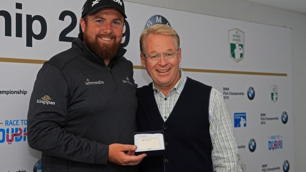 Shane Lowry is presented with Honorary Life Membership of The European Tour by Keith Pelley. Photo: Andrew Redington/Getty Images
