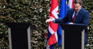 Invisible man: Boris Johnson fails to join Luxembourg prime minister Xavier Bettel for a joint press conference. Bettel gestures to an empty podium. Photograph: Joshua Sammer/Getty