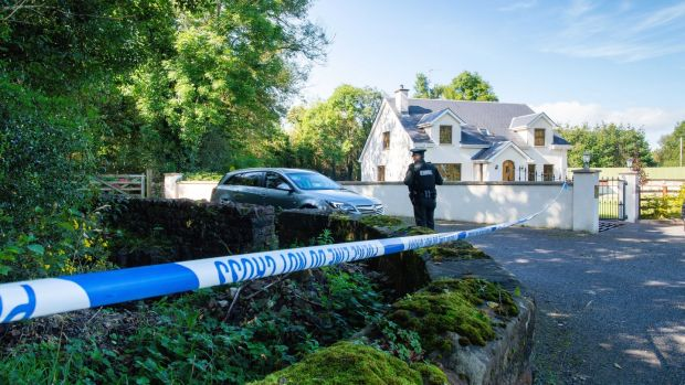 The laneway where Quinn Industrial Holdings director Kevin Lunney was abducted is cordoned off by PSNI officers. Photograph: Ronan McGrade/Pacemaker Press