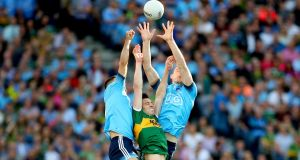 Dublin's James McCarthy and Brian Fenton with David Moran of Kerry during  the GAA  All-Ireland senior football final replay, in Croke Park, Dublin. Photograph: ©INPHO/James Crombie