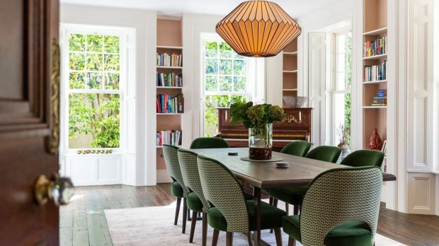 Dining room: Well-upholstered velvet chairs are at the centre of this dual aspect room