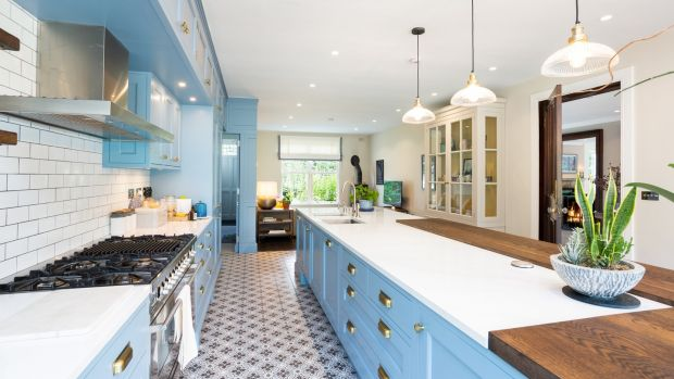 Kitchen: the units in this space are a warm, cornflower blue colour