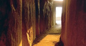 Sun coming up the passage at the Winter Solstice, Newgrange