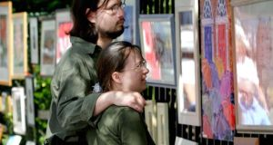 A couple enjoy the work on show in the Merrion Square Open Art Exhibition. File photograph: Bryan O'Brien