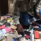 A Kenyan hawker sells mobile phone covers on a street, in Nairobi. Photograph: Simon Maina/Getty