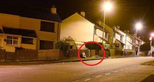 A photograph made available by the PSNI shows the scene where an improvised explosive device was discovered during a search operation in the Creggan area of Derry.