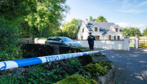 PSNI officers at the laneway at Kinawley in Co Fermanagh where Quinn Industrial Holdings director Kevin Lunney was abducted   on Tuesday. Photograph: Ronan McGrade/Pacemaker Press