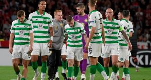 Celtic manager Neil Lennon congratulates his players at the end of the Europa League Group E  match against  Rennes at Roazhon Park stadium. Photograph: Sebastien Salom-Gomis/AFP/Getty Images