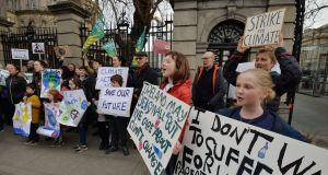 Flossie Donnolly from Sandycove and Phoebe Ford from Dalkey with other members of Climate Strike Fridays for Future protesting about Climate Change outside the Dail earlier this year. Photograph: Alan Betson / The Irish Times