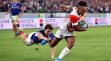 Kotaro Matsushima scores his third try and Japan's fourth against Russia. Photograph: Ashley Western/PA