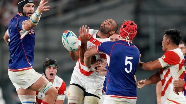 Japan's Michael Leitch challenges for the ball with Russia's Bogan Fedotko (R). Photograph: Franck Robichon/EPA