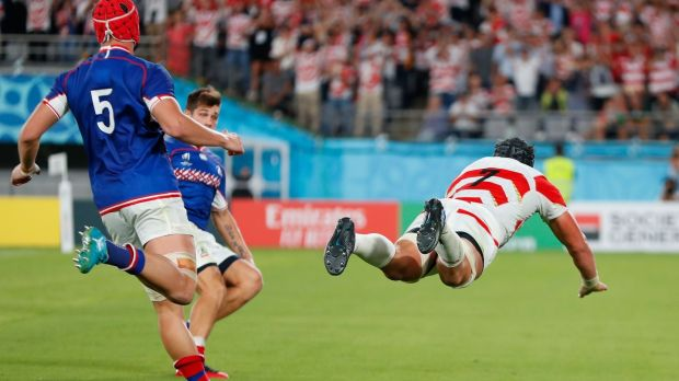 Pieter Labuschagne dives to score for Japan. Photograph: Odd Andersen/AFP/Getty