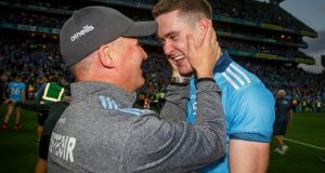 Dublin's Brian Fenton celebrating with manager Jim Gavin after the All–Ireland final replay in Croke Park. Photograph: Oisin Keniry/Inpho