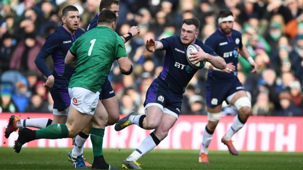 Stuart Hogg prepares to hand off Ireland prop Cian Healy during the Six Nations match between Scotland and Ireland at Murrayfield last February. Photograph: tu Forster/Getty