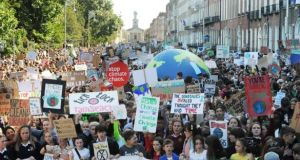Students at the global climate change strike in Dublin's Merrion Square on Friday. Photograph: Aidan Crawley