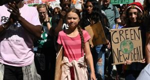 Teen climate activist Greta Thunberg walks with protesters during the Global Climate Strike march in New York. Photograph:  Getty Images