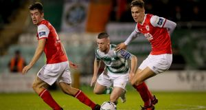 Jack Byrne of Shamrock Rovers tries to go through Leigh Desmond and Cian Coleman of St Patrick's Athletic during the SSE Airtricity League Premier Division match at Tallaght Stadium. Photograph: Oisín Keniry/Inpho