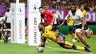 Samu Kerevi scores Australia's crucial fifth try in Sapporo. Photograph: Dan Mullan/Getty