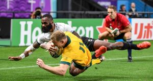 Australia's wing Reece Hodge scores a try against  Fiji. Photograph: Getty Images