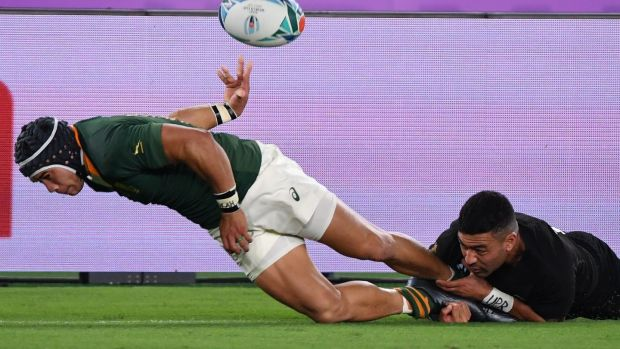 New Zealand's outhalf Richie Mo'unga tackles South Africa's wing Cheslin Kolbe. Photograph: Toshifumi Kitamura/Getty Images