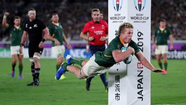 Pieter-Steph du Toit of South Africa dives to score a try in the second half. Photograph: Mike Hewitt/Getty Images