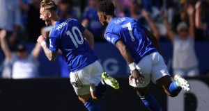 James Maddison celebrates scoring Leicester City's  second goal with Demarai Gray during the Premier League match against  Tottenham Hotspur at The King Power Stadium. Photograph: Laurence Griffiths/Getty Images