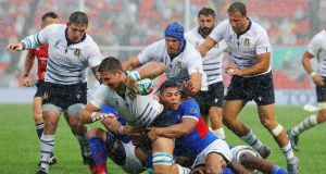 Jake Polledri of Italy is tackled during the Rugby World Cup 2019 Group B game between Italy and Namibia at Hanazono Rugby Stadium in Higashiosaka, Osaka, Japan. Photo: Koki Nagahama/Getty Images