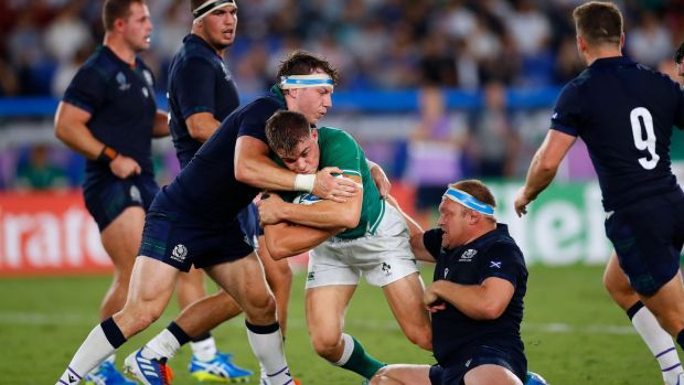 Garry Ringrose is tackled during the match. Photo: Odd Andersen/AFP/Getty Images