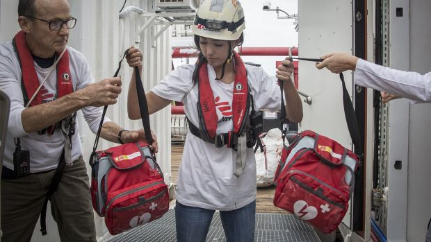 MSF Logistician Shaun Cornelius and Humanitarian Affairs Officer, Yuka Crickmar, move the Automated External Defibrillators (AED) from the storage to the medical clinic. The AED is used for resuscitation of patients in cardiac arrest.