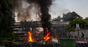 A barricade is set on fire by anti-government protesters during a rally in Shatin, Hong Kong. Photograph: Jerome Favre/EPA