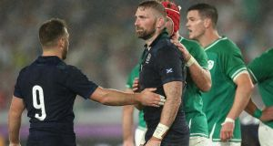 Greig Laidlaw consoles John Barclay during Scotland's 27-3 in Yokohama. Photograph: Cameron Spencer/Getty