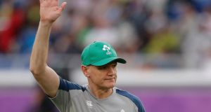 Head coach Joe Schmidt waves to fans  before Ireland's World Cup opener against Scotland. Photograph:   Stu Forster/Getty Images
