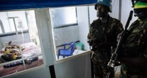 UN soldiers at  an ebola treatment centre in  the North Kivu province of  the Democratic Republic of Congo. Photograph:  Alexis Huguet/AFP/Getty Images