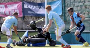 Three Rock's David Kane fails to stop Conor Empey of UCD scoring a goal in the student side's 3-1 win at the weekend. Photograph:  Bryan Keane/Inpho