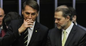 Brazilian far-right president-elect Jair Bolsonaro (left) with  supreme court president José Dias Toffoli. Photograph:  Sergio Lima/AFP/Getty Images
