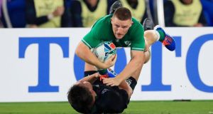 Ireland's Andrew Conway in action with Sean Maitland of Scotland during their 27-3 victory in International Stadium, Yokohama. Photograph: Craig Mercer/Inpho
