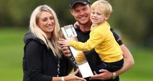 Danny Willett celebrates his victory in the  BMW PGA Championship at Wentworth with his wife Nicole and son Zachariah James. Photograph: Bradley Collyer/PA Wire