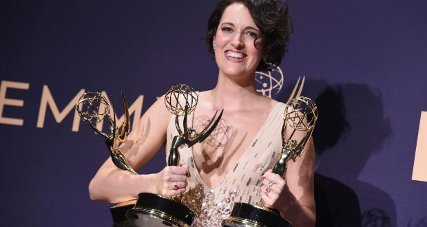 Phoebe Waller-Bridge with the three Emmys she won for her series Fleabag. Photograph:  Jordan Strauss/Invision/AP