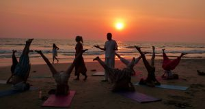 Yoga class on the Varkala Beach at sunset. File photograph: iStock
