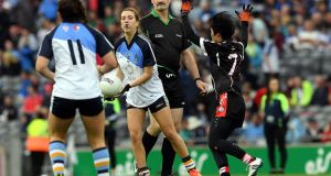 Paraic McGrath referees the match between Japan GAA Ladies (in black) and UCD International Ladies in an invitational match on August 5th, 2017 in Croke Park.