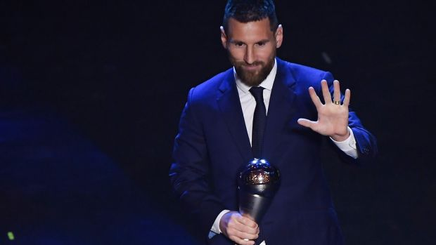 Argentina and Barcelona forward Lionel Messi reacts after winning the Fifa player of the year award in Milan. Photograph: Marco Bertorello/AFP/Getty Images