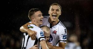Dundalk's Daniel Kelly, Chris Shields and Georgie Kelly celebrate winning the league after the 3-2 win over Shamrock Rovers at Oriel Park. Photograph:   Morgan Treacy/Inpho