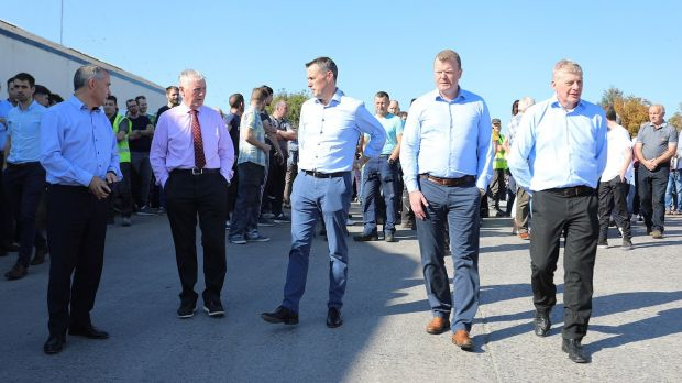 Liam McCaffrey, John 'Bosco' O'Hagan, Dara O'Reilly, John McCartin and Tony Lunney, brother of Kevin Lunney, lead the rally of support by the staff of Quinn Industrial Holdings in Derrylin on September 20th, a few days after the attack on Kevin Lunney. Photograph: Lorraine Teevan